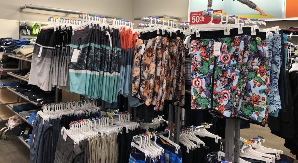 Men's swimwear on hangers on display in-store