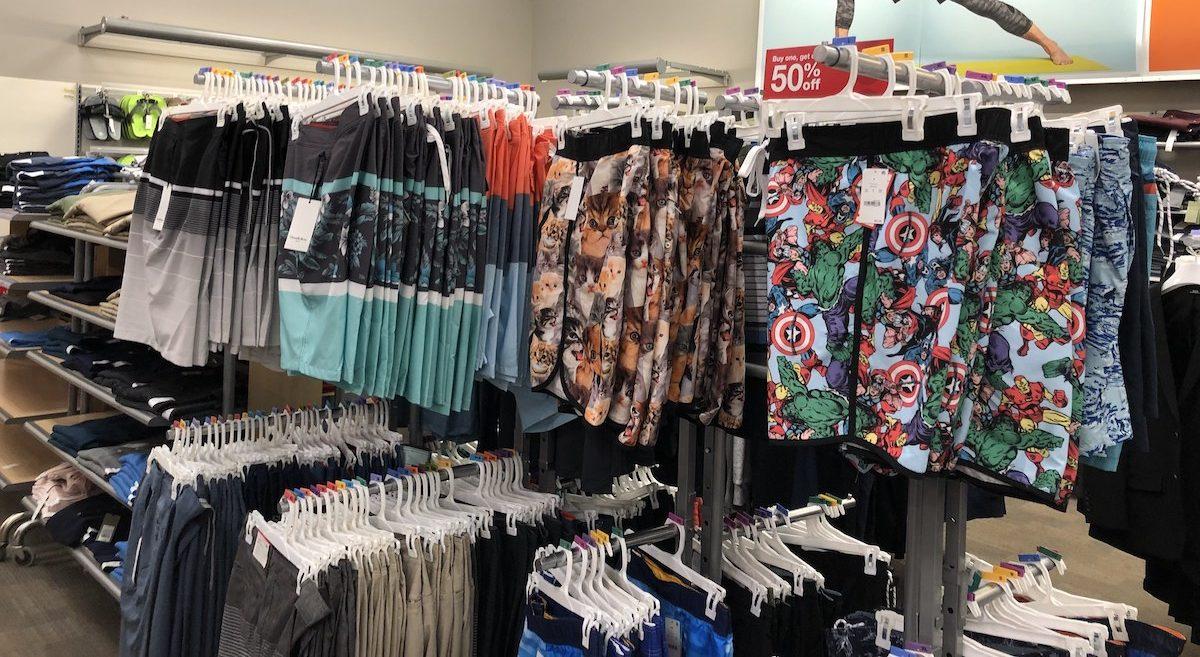 men's swim trunks hanging on clothing racks at Target