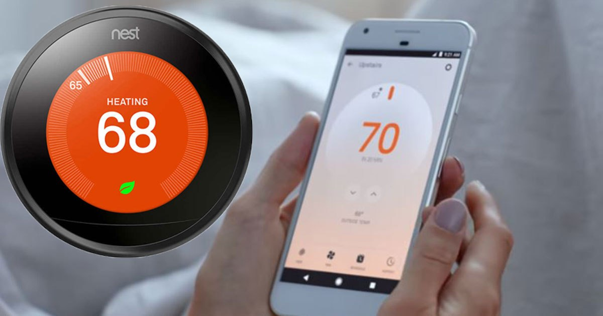 Nest Thermostat Black and smart phone being held that shows the Nest app