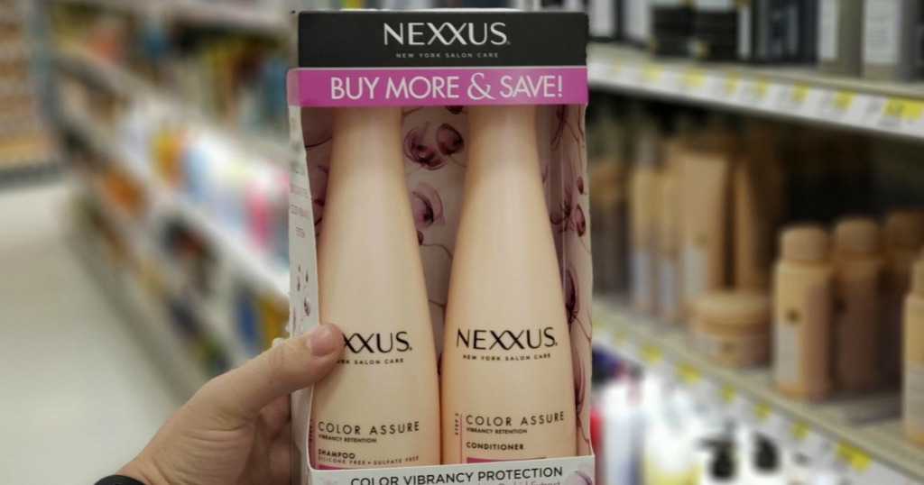 hand holding 2 pack of nexxus color assure shampoo and conditioner