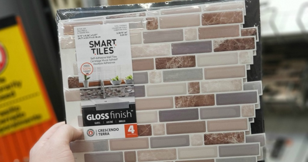 hand holding up smart tiles