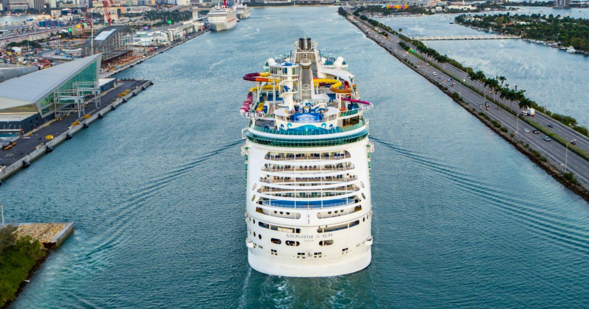 cruise ship leaving a harbor
