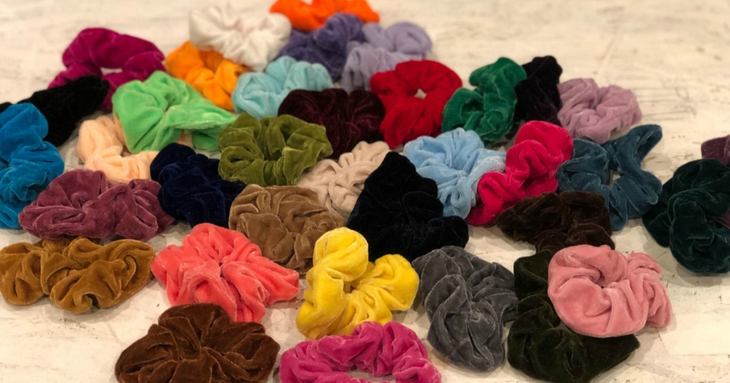 huge pile of velvet scrunchies laying next to each other