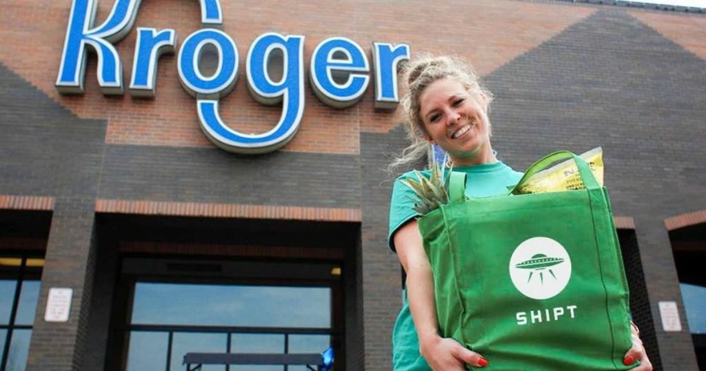 Holding Shipt bag at Kroger