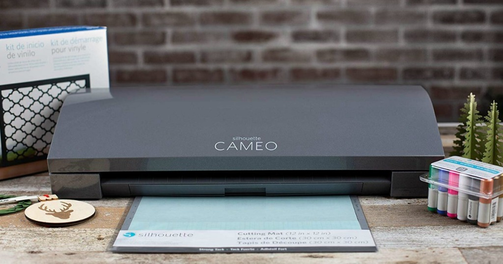 Silhouette Cameo 3 machine on desk with cutting mat, Sketch pens