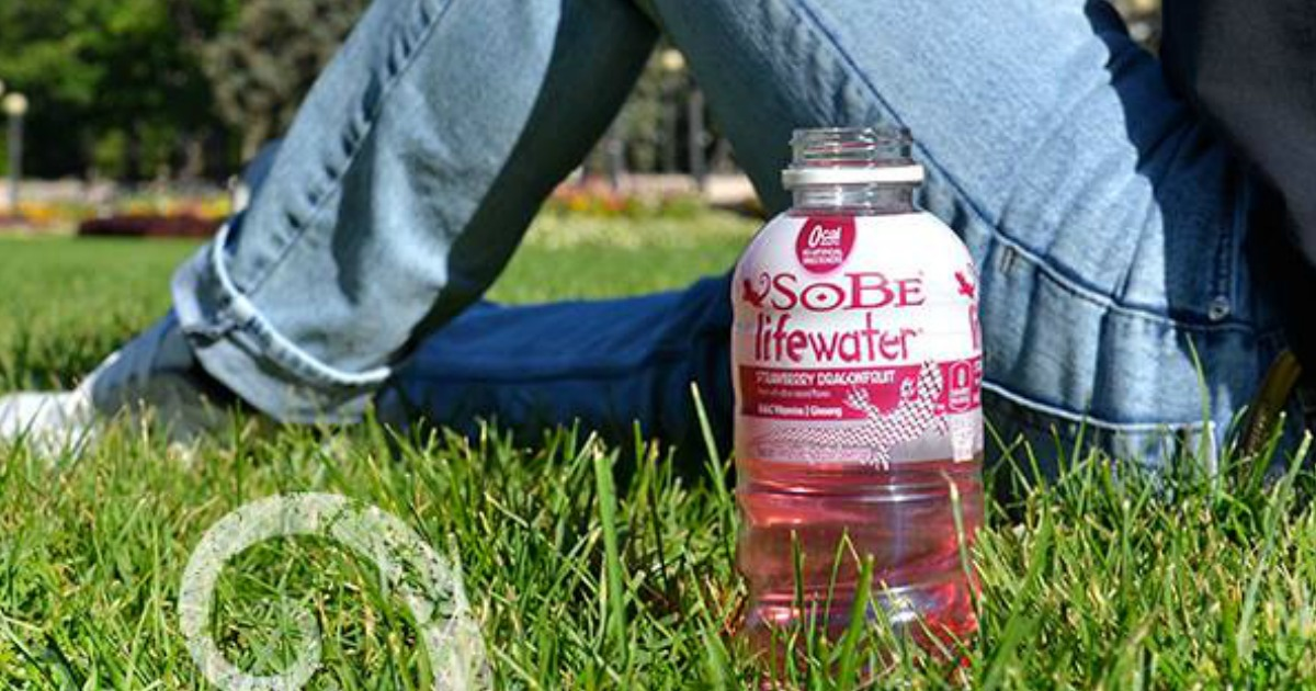 Sobe Water - Lifewater on grass with person lying beside bottle