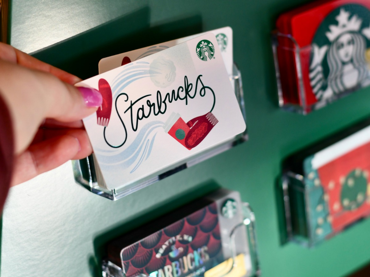 woman taking Starbucks Gift Card