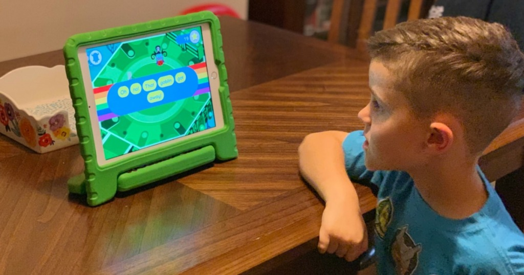 little boy watching tablet