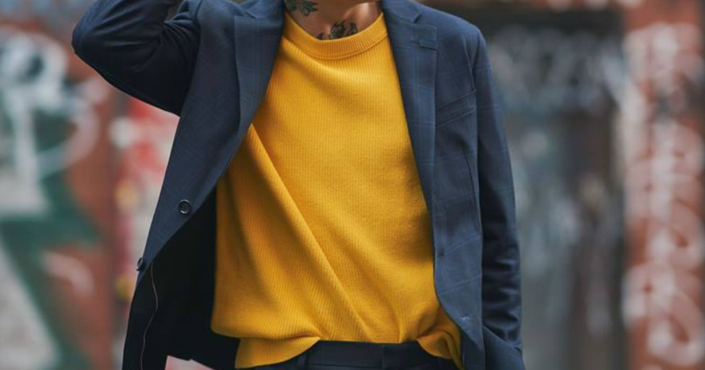 man in navy blue blazer with yellow sweater