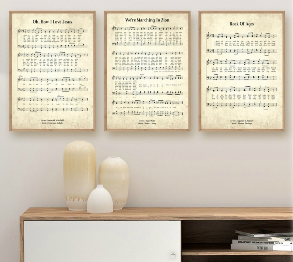 vintage hymn prints hanging on wall