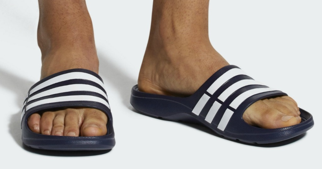 adidas sandals being worn by male