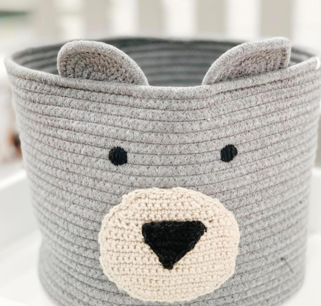 gray rope basket with bear face