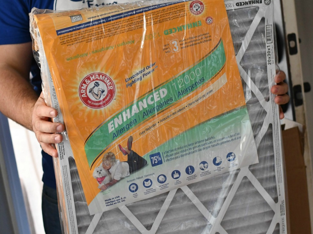 person holding up arm and hammer enhanced air filters