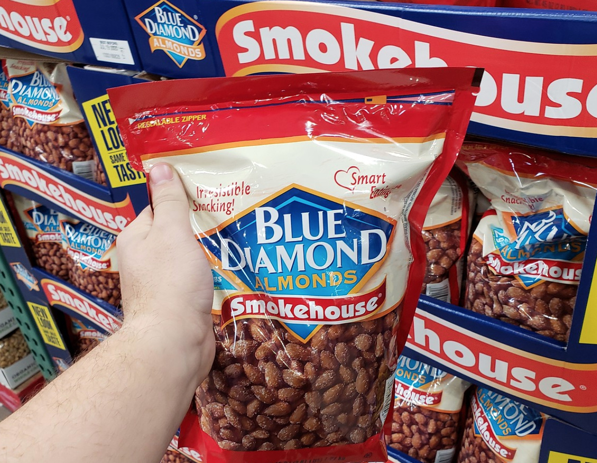 man holding up a large bag of Blue Diamond almonds