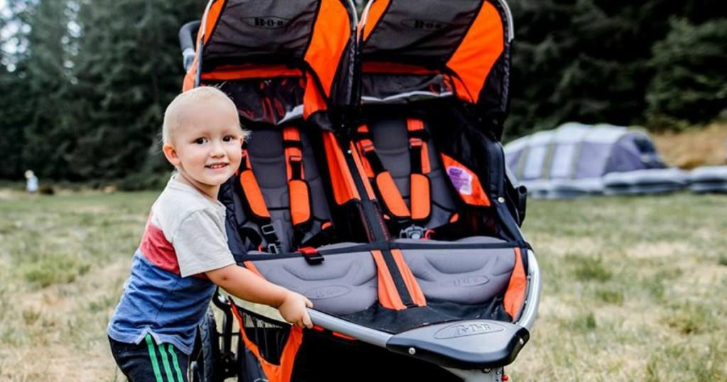 child with bob revolution stroller