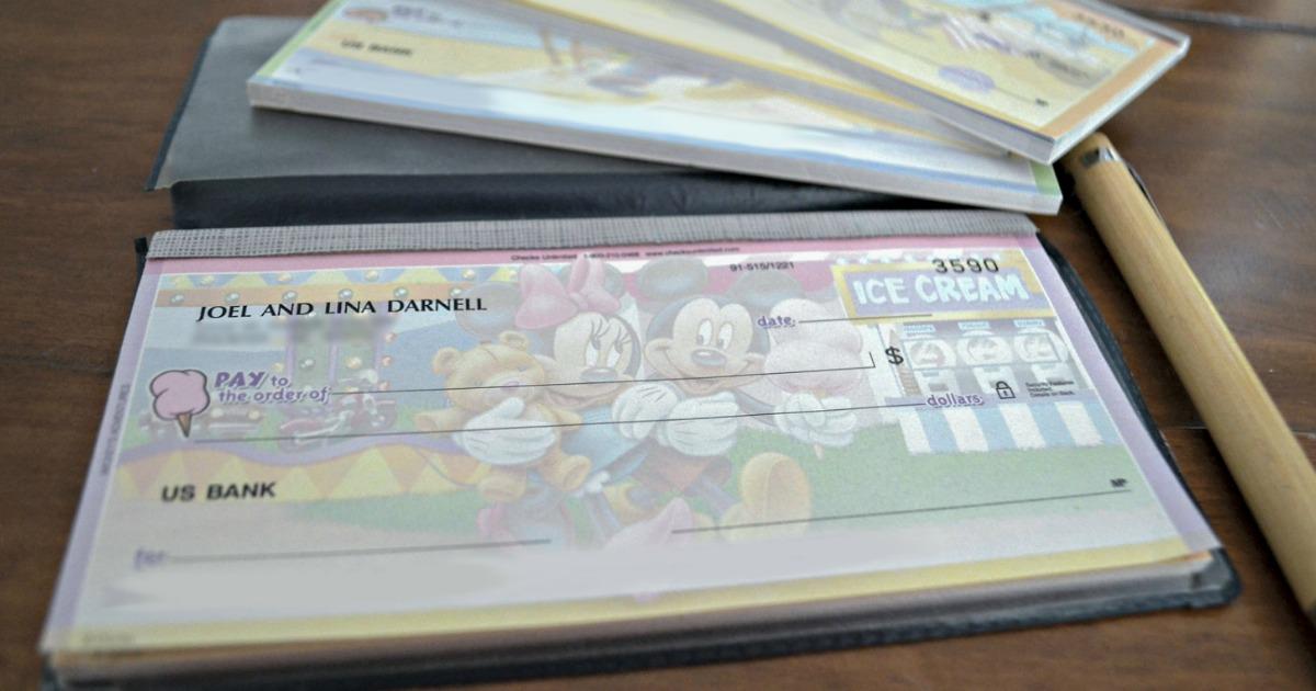 Disney Bank checks on a table