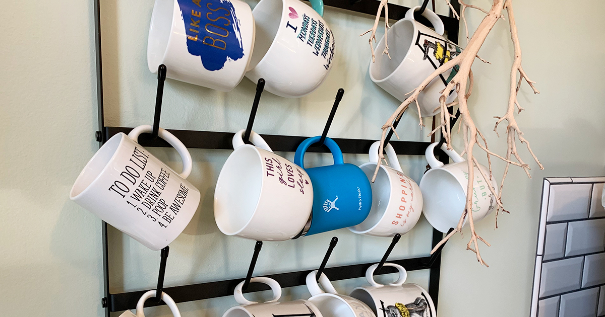 coffee mug rack with various coffee mugs
