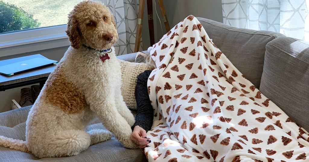 yoli and collin with poop emoji blanket