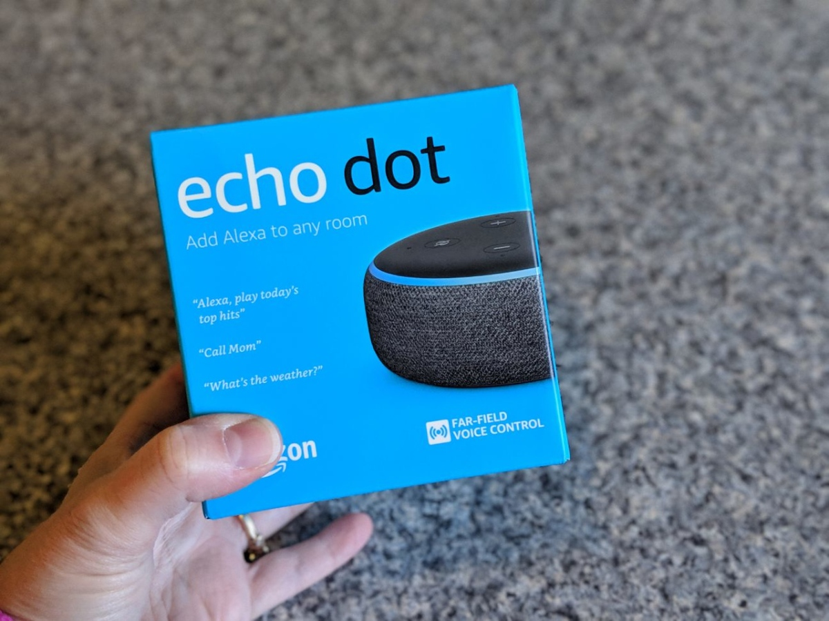 hand holding echo dot