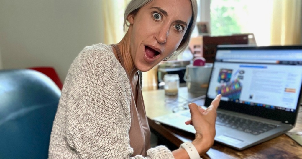 woman pointing at screen with mouth open