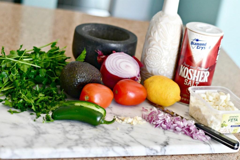 feta salsa ingredients sitting on counter
