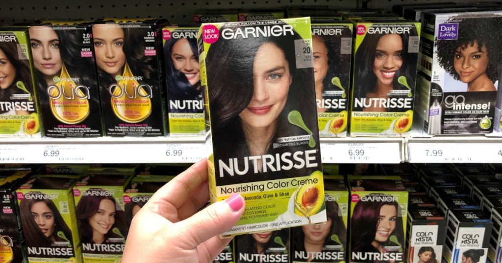 hand holding up a box of garnier hair color