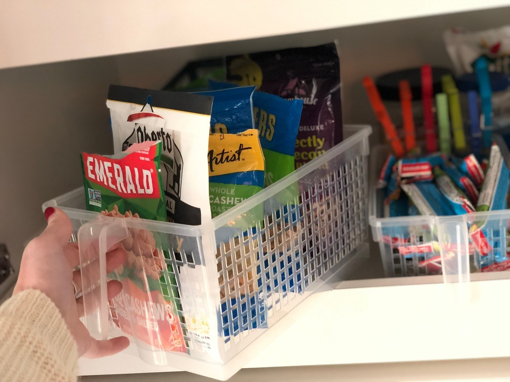 pulling out pantry organizer basket with nuts inside