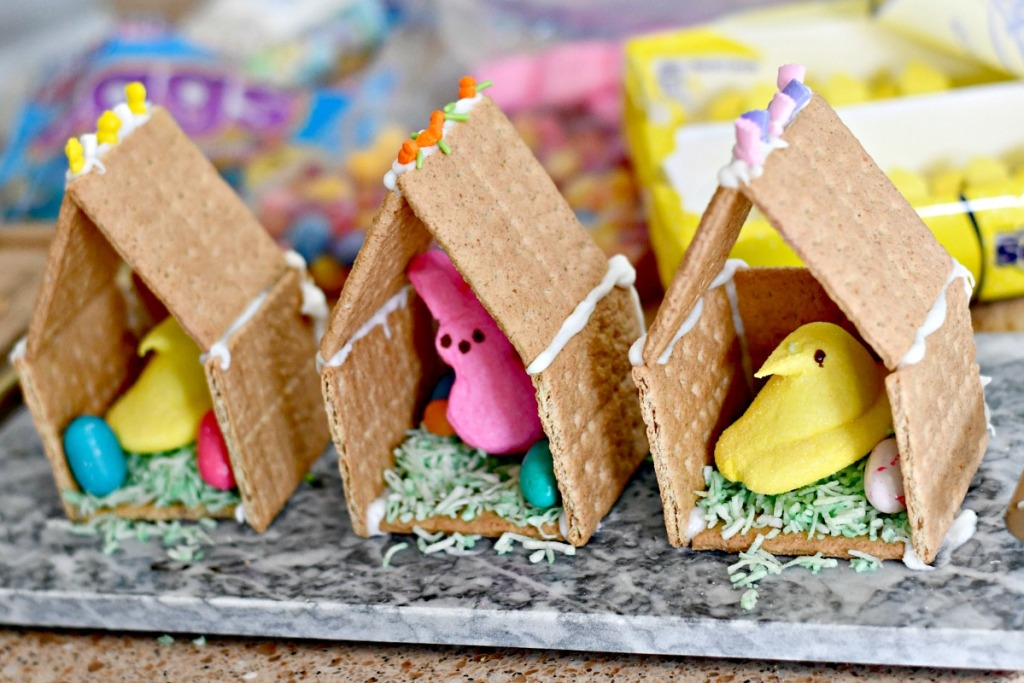 graham cracker houses with Easter Peeps and candy inside