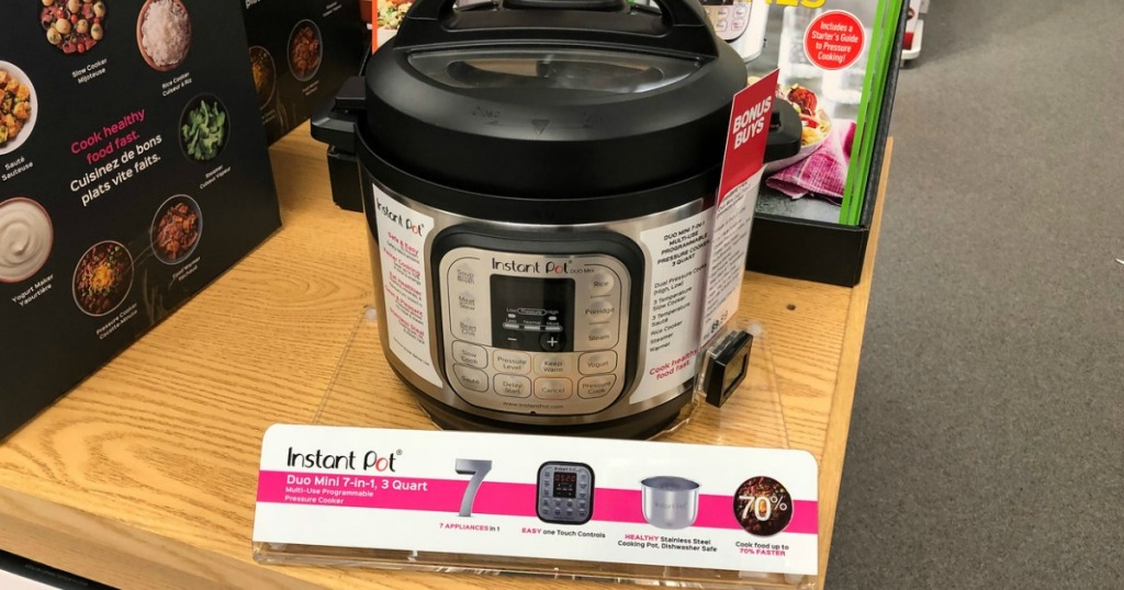 pressure cooker sitting on store shelf near store sign