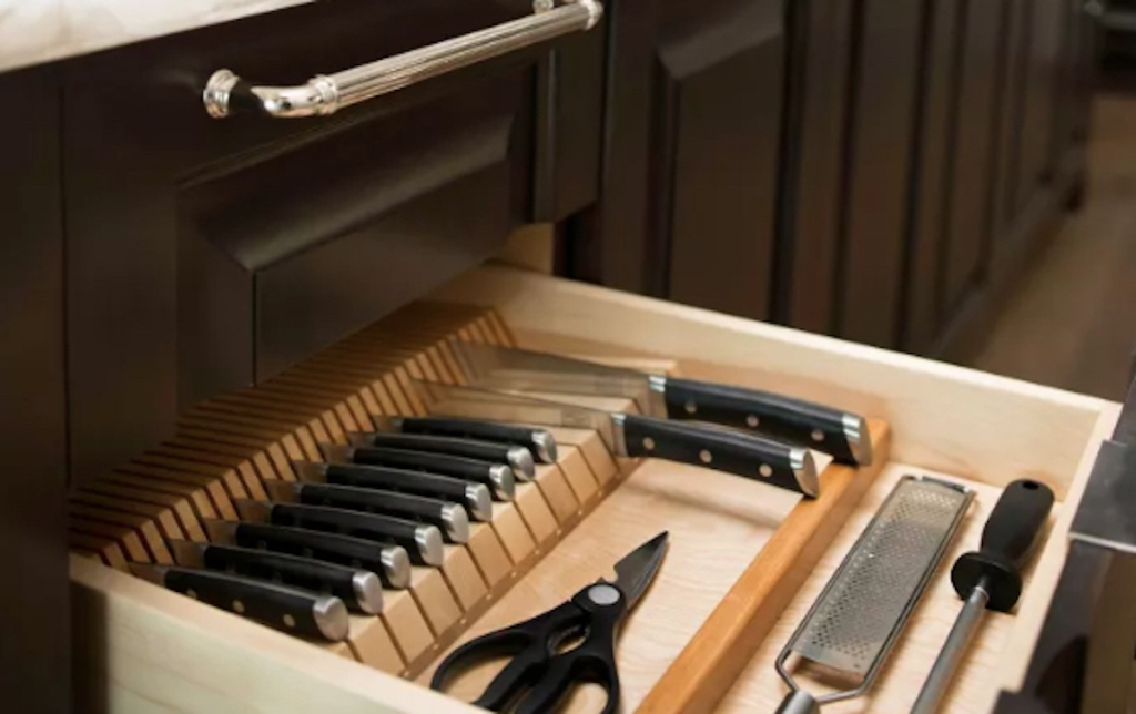 knife block organizer with knives in kitchen drawer