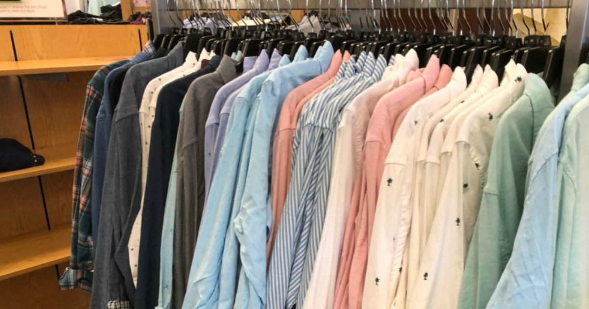 men's button-down shirts hanging on a rack