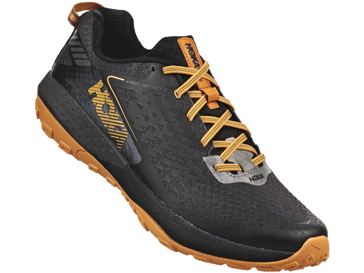 Hoka sneaker in black with orange laces