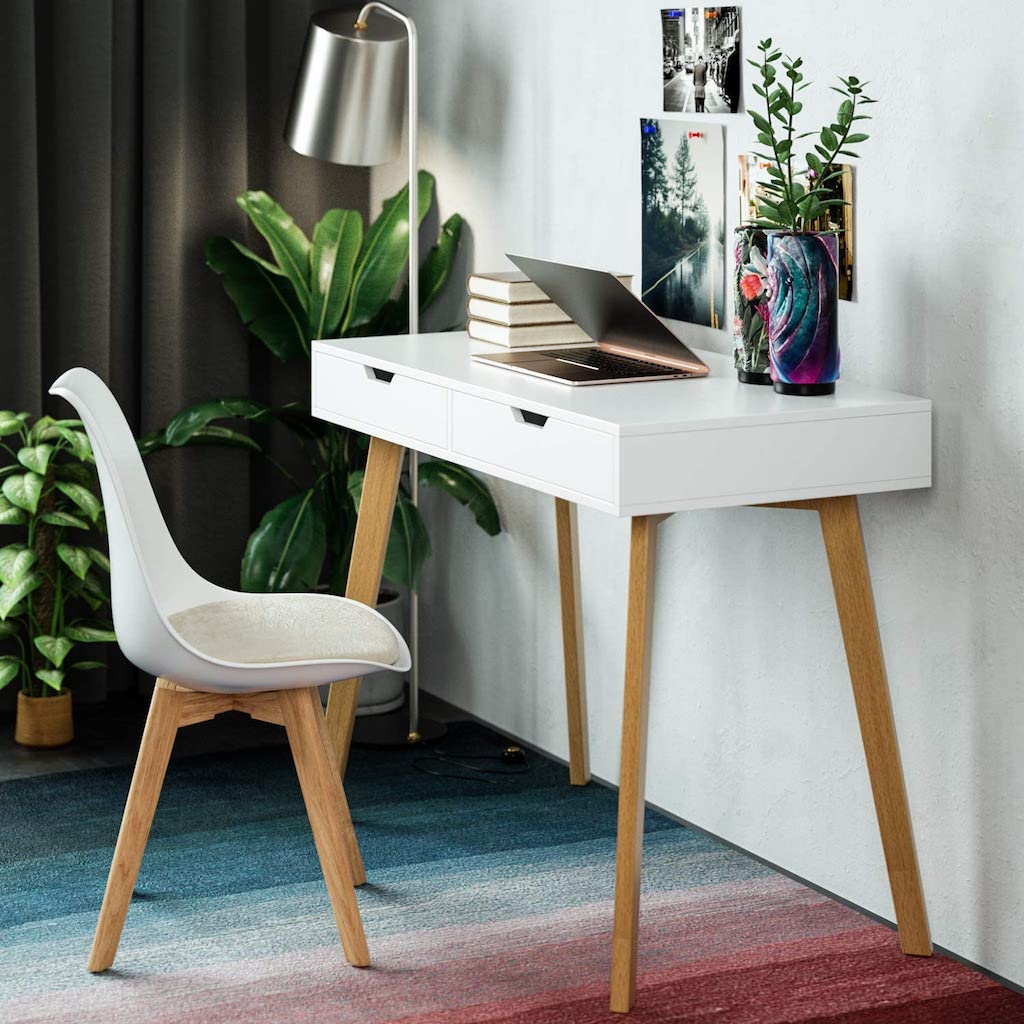modern desk with laptop and plants