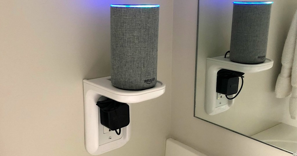 amazon echo on outlet shelf in bathroom