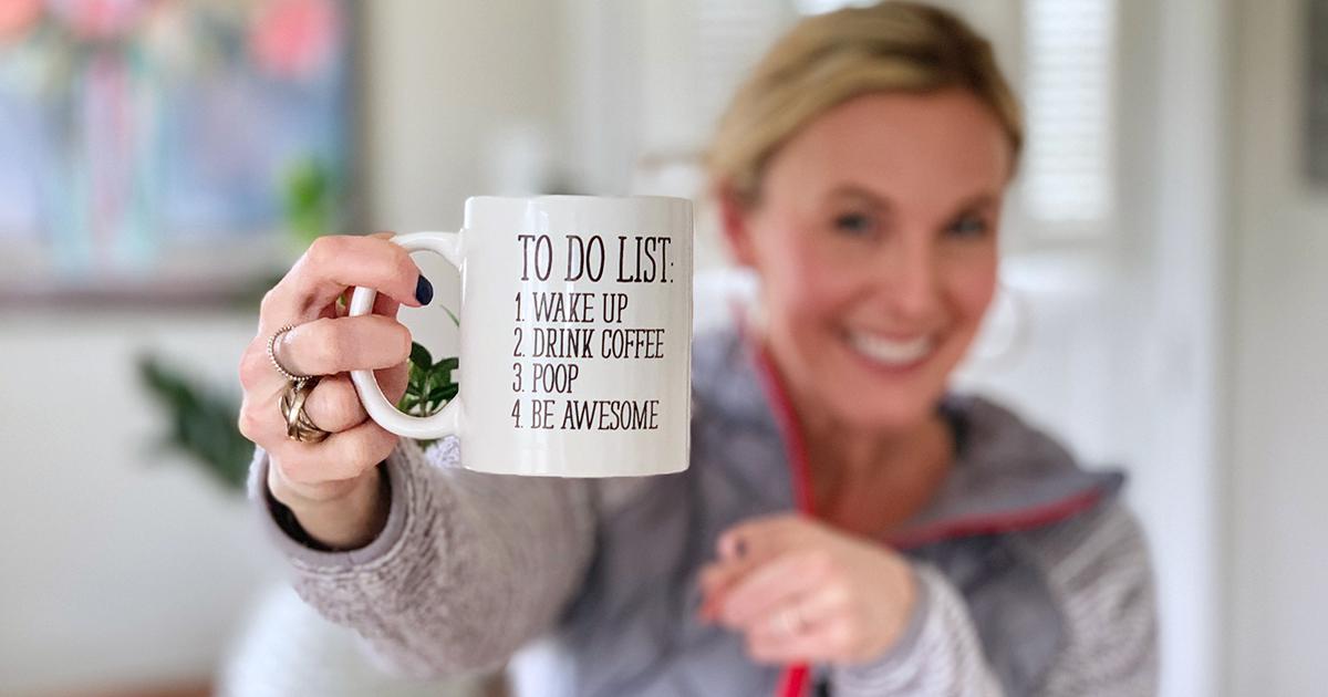 collin holding up to-list coffee mug