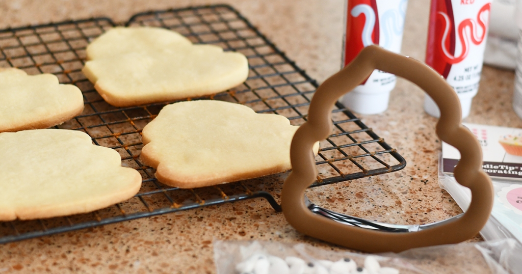 poop emoji shaped cut out cookies and cutter
