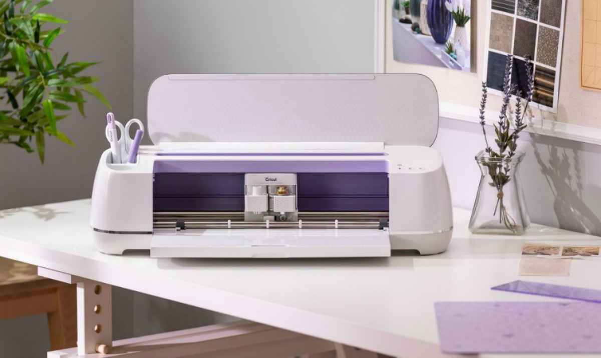 purple cricut maker machine on work desk