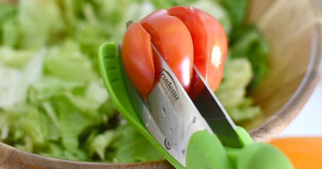 cutting through tomatoes with salad tongs