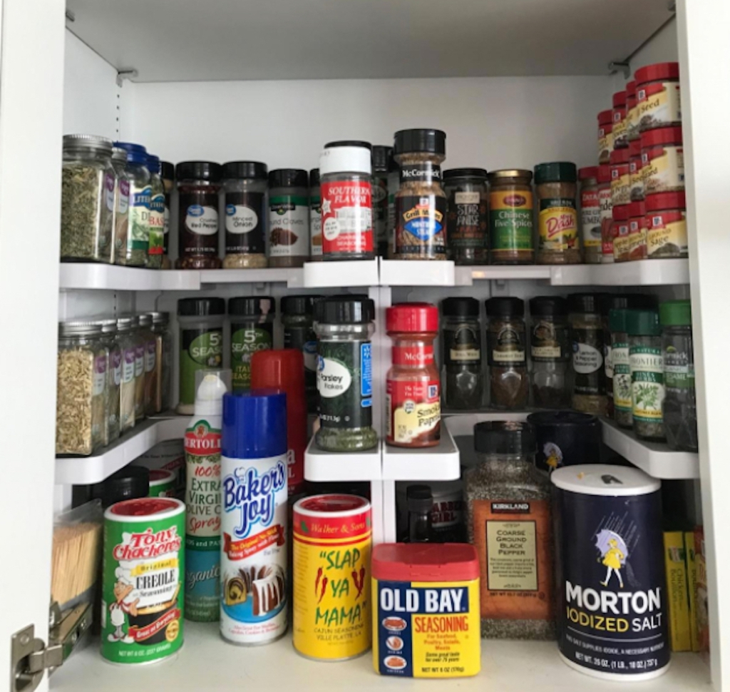 various spices in cabinet with shelves inside