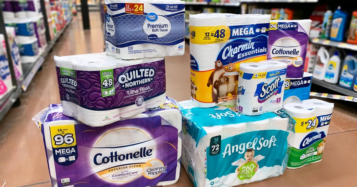 various stacks of toilet paper in aisle