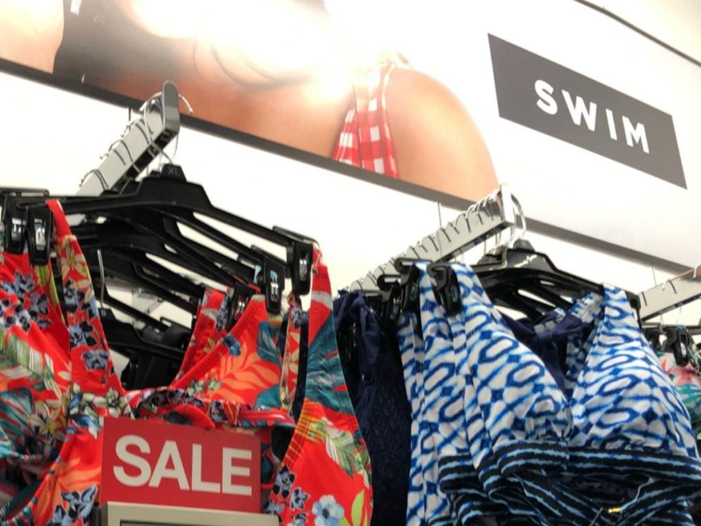 women's bikini swimwear on sale hanging on rack