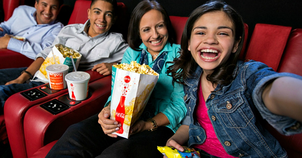a girl taking a family selfie at the movies