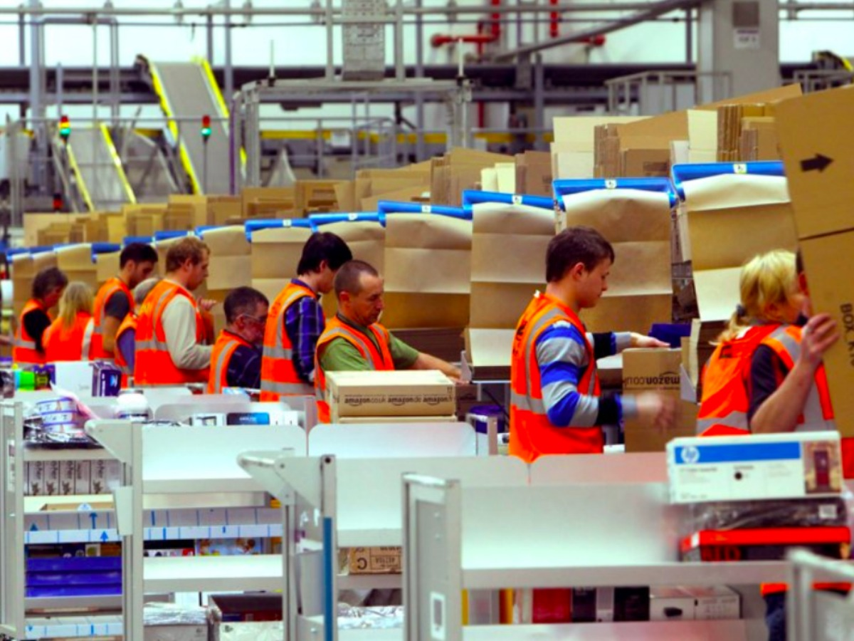 Amazon workers in an Amazon plant
