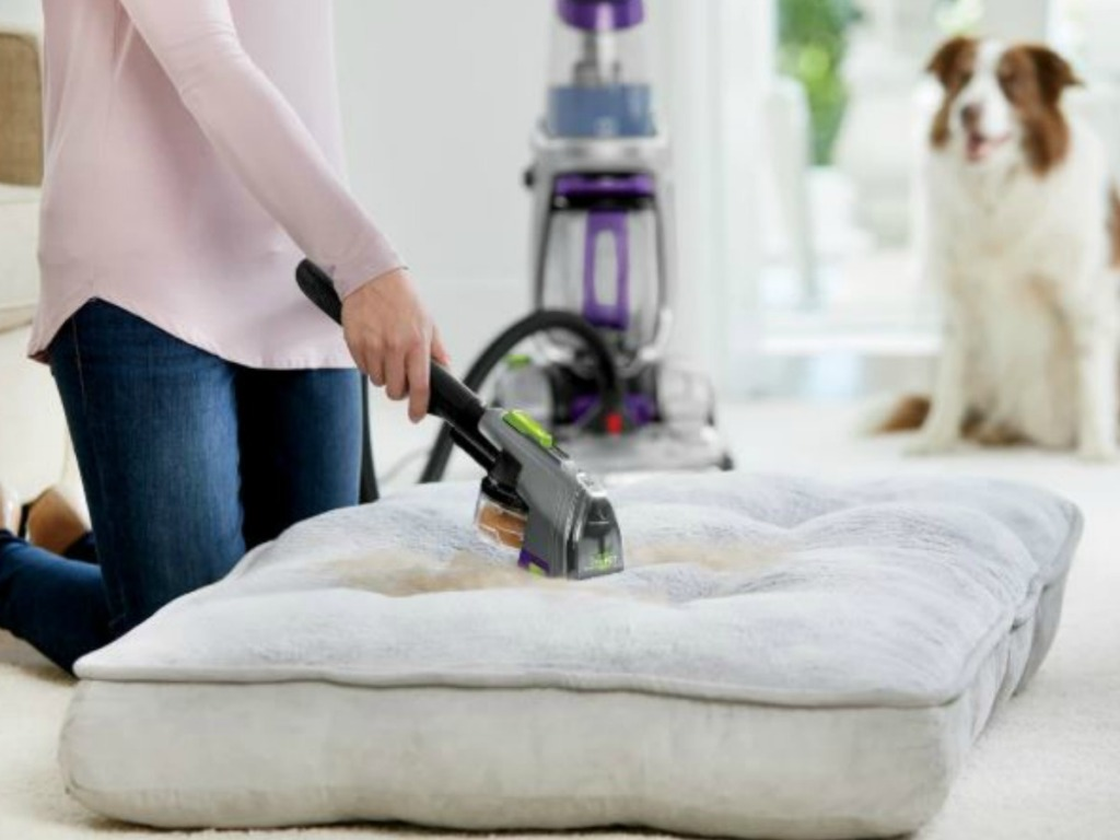 woman using tool from BISSELL ProHeat 2X Revolution Pet Pro Carpet Cleaner on couch