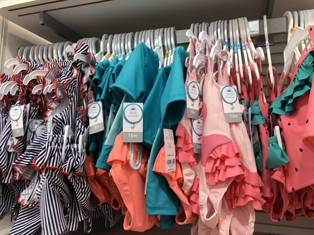 Carter's swimsuits on hangers
