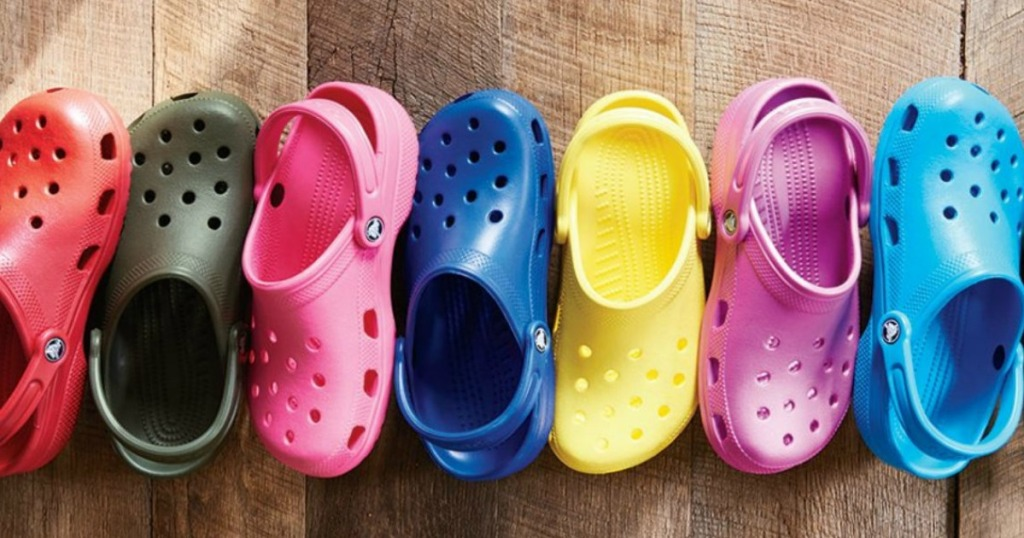 line of colorful Crocs clogs on the floor