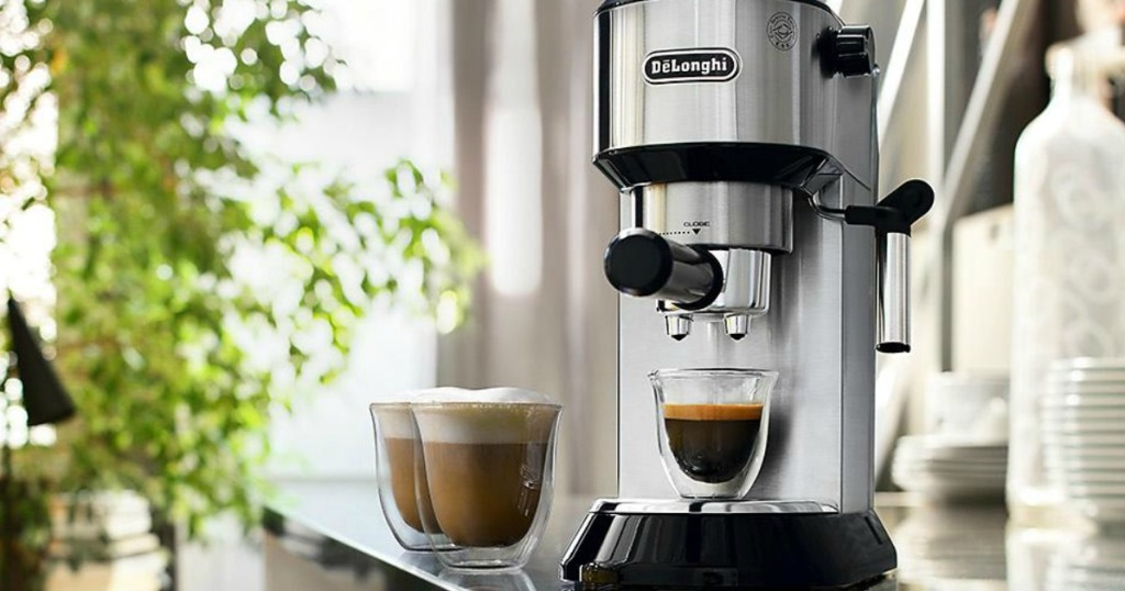 DēLonghi Dedica Espresso and Cappuccino Machine on counter with three glasses
