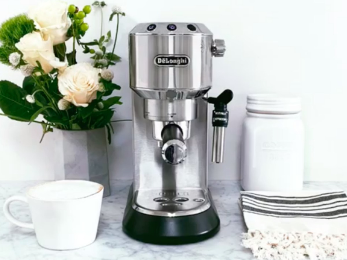 DēLonghi Dedica Espresso and Cappuccino Machine on counter with roses and more