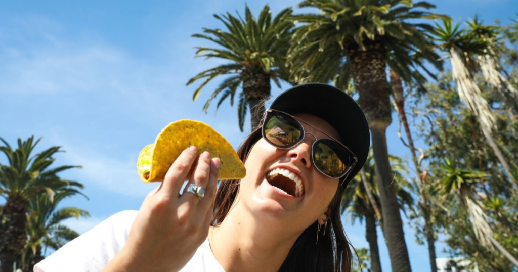 Del Taco girl eating a taco