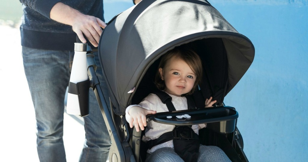 child riding in stroller